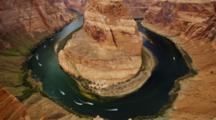 Looking Down On Horseshoe Bend, Arizona, Mesa And Colorado River With Speed Boats.