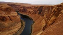 Horseshoe Bend, Arizona, Mesa And Colorado River. Sun Reflected In The River.