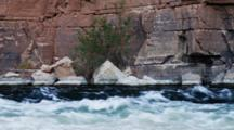 River Rapids At Lees Ferry, Mixed Color Waters, Fast Current, Many Colored Rocks And Plants.