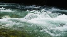 Rushing River Flowing Over Rocky Bottom, White Water And Glacial Influence.