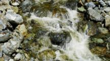 One Third In, Shot Tilts Up Stream. Rushing River Flowing Over Rough Rocks.