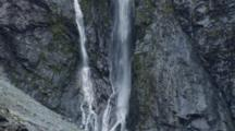 Pan From Base To Top Of Long Waterfall In Milford Sound Area.