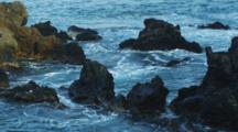 Coastal Lava Rocks In The Tidal Surge Of Low Tide, Kailua-Kona, Kealakekua Bay, Hawaii.