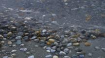 Colorful Rocks And Sand Washed By Waves In Lake Manapouri.