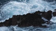 Waves Crash Over Rock