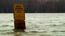 Wildlife Management Sign Immersed In High Water On Flood Plain