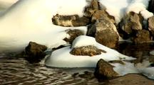 Cold Winter Snow On Exposed Rock