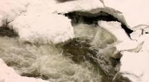 Section Of Vermillion Falls Rushes Past Snow And Ice