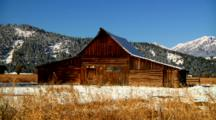 Historic Mormon Row Barn Framed By Mountains In Grand Teton National Park