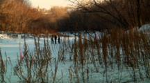 People Walk On Unsafe River Ice Despite Warning Sign