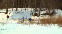 Winter Enthusiasts Snowshoe And Hike Outdoors