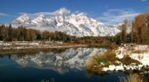 Rugged Teton Mountain Range Reflects In Snake River