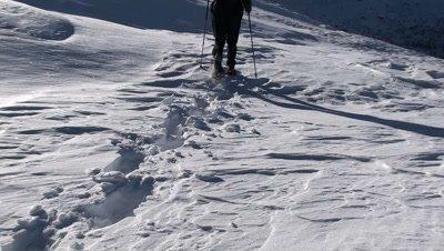 Woman trekking on a snow field