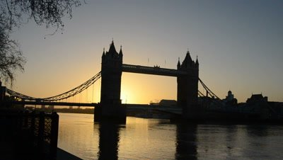 time lapse,sunrises behind river Thames and silhouetted Tower bridge