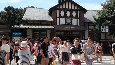 People walking,crossing street in front of JR Harajuku Station,Tokyo,Japan