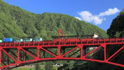 train passes over Sagano Scenic Railway Bridge,Toyama Prefecture,Japan