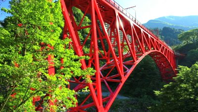 looking up at train passes over Sagano Scenic Railway Bridge,Toyama Prefecture,Japan