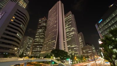 Time-lapse pan down view of Sompo Japan Head Office Building and traffic in Shinjuku at night,Tokyo,Japan