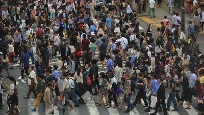 People walking at Shibuya scramble crossing, Tokyo, Japan