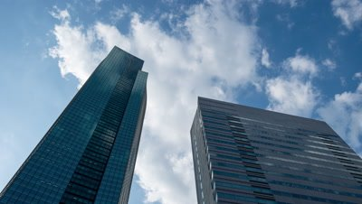 Time-lapse looking up at buildings in Shiodome business district,Tokyo,Japan