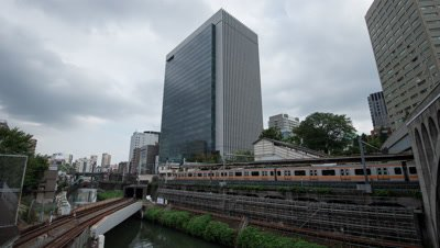 Time Lapse View Of Rail Tracks And Clouded Sky In Ochanomizu Office District,Tokyo,Japan