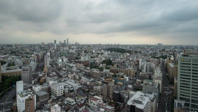 Time Lapse Pan Up View Of Tokyo Cityscape and Clouded Sky,Tokyo,Japan