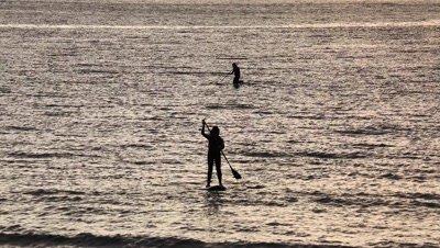 Paddle surfers at sunset in Enoshima,Kanagawa Prefecture,Japan