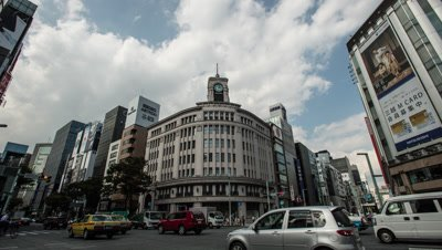 Time lapse view of traffic in front of Wako building in Ginza, Tokyo, Japan