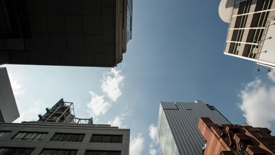 Looking Up,Time lapse clouds over office buildings in Ginza,Tokyo