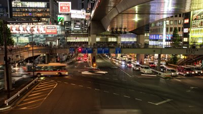 Time lapse footage of pedestrians and vehicles passing by in Shibuya at night, Tokyo, Japan
