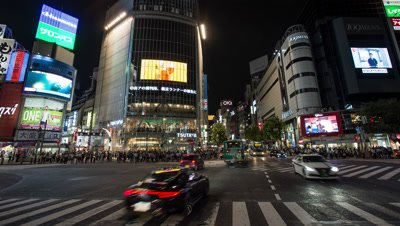 Time lapse footage of pedestrians and vehicles at Shibuya scramble crossing at night, Tokyo, Japan