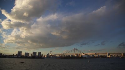 Time lapse day to night view on Tokyo Bay and Rainbow bridge during fireworks festival,Tokyo,Japan