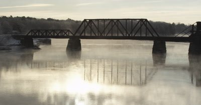 Timelapse of bridge and early morning winter mist
