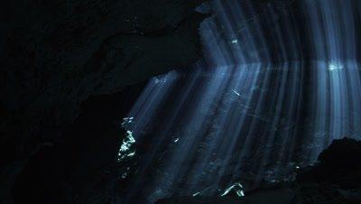 A Diver Explores a Cenote in Mexico