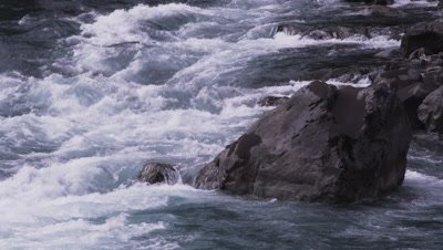 Rapids on a  fast moving river