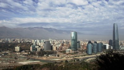 The City skyline of Santiago, Chile lies between mountains and extensively traps smog