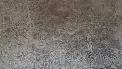 Bas-relief stone carving around Angkor Wat castle, Cambodia, 4k