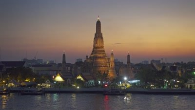 Landscape with Wat Arun at twilight time. Buddhist temple located along the Chao Phraya river in Bangkok, Thailand  4k