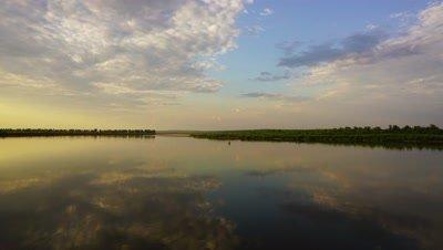 landscape with barge on river at sunset, timelapse, 4k