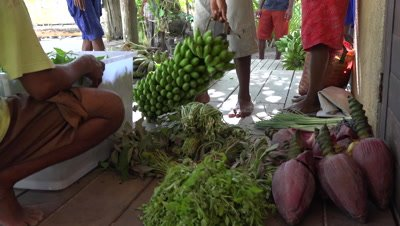 Papuan locals piling up fruits and vegetables for sale