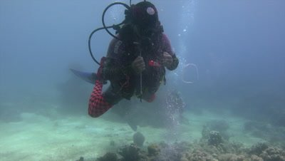 Diver doing tricks with bubbles