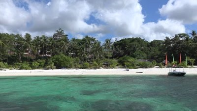 View of sandy beach on Bohol Island from boat as driving away