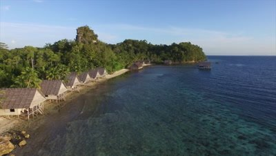Flying over coral reef on the main bay of Pulau Pef in Raja Ampat