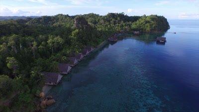 Flying over reef at a remote island resort of Pulau Pef in Raja Ampat