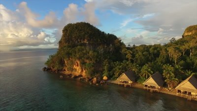 Pan across water bungalows on Pulau Pef in Raja Ampat