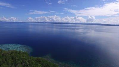 Pan over pristine coast and mangroves on Pulau Pef in Raja Ampat