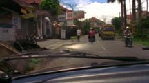 Drive Through Indonesian Street With Mopeds