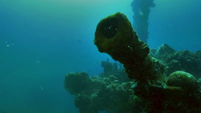 approaching old ship canon on sunken ship,japanese wreck in Palau