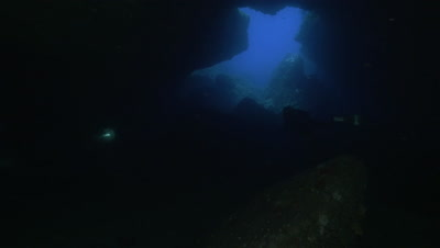 underwater shot of cave interior,very dark ambiance