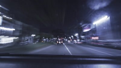 Fast night car drive timelapse through the city of San Francisco